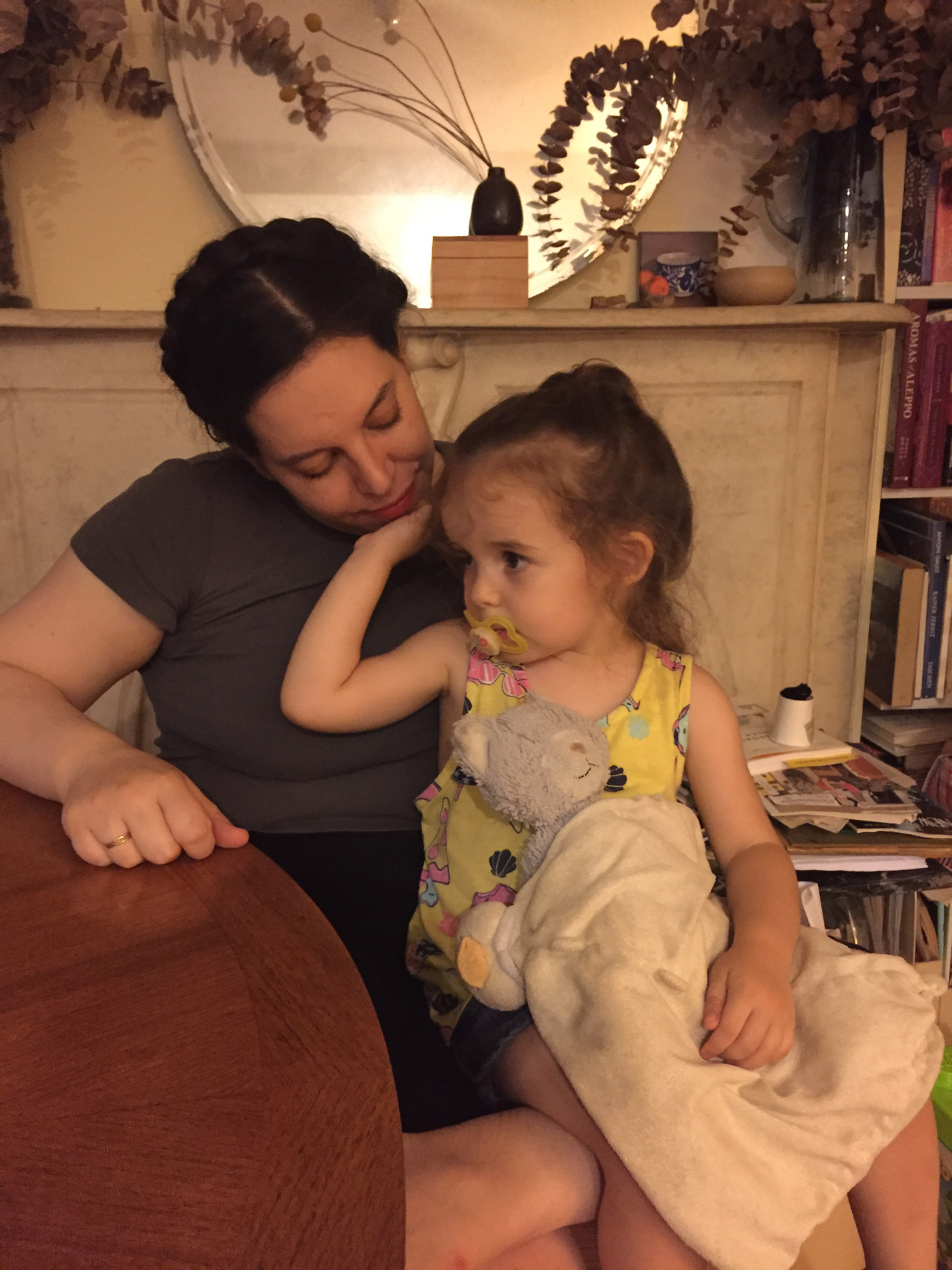 The author's sister holds her young child in a cozy living room